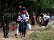 Myanmar refugees in Thailand's border return home