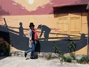 Korean artists resumes mural project in fishing commune