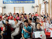 VN Red Cross hailed for two decades of Tet relief for the poor, AO victims