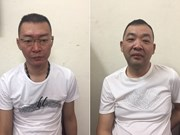 Vietnam hands over two wanted men to China