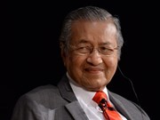 Malaysian PM promises to hand power after two years