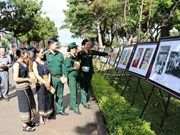 Photo exhibition honours late painter Xu Man