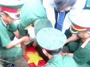 Remains of 30 voluntary soldiers reburied in Dien Bien