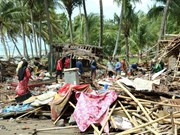 Indonesian villagers return home after tsunami