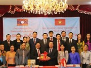 Political theory books presented to Laos