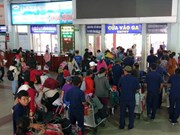 HCM City ensures transport for people returning home for Tet