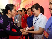 HCM City officials join workers in Tet celebration