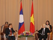 Party, State leader lauds joint work between Vietnamese, Lao fronts