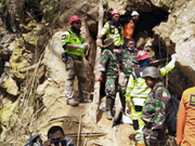 Indonesia stops search for mine collapse victims