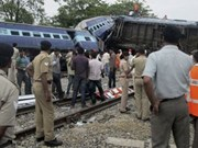 Tens injured after train derails in Indonesia
