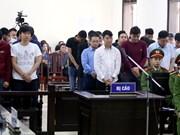 Prison terms reduced for 13 defendants in major gambling ring