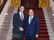 PM Nguyen Xuan Phuc meets economist Philipp Rosler