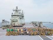 HMAS Canberra docks at Thailand's Patong bay
