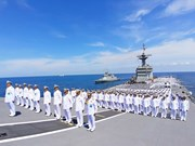 Thail naval officers on HTMS Chakri Naruebet offer blessings to King