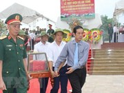Quang Binh lays martyrs in Laos to rest