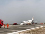 Myanmar Airlines plane lands safely after landing gear fails