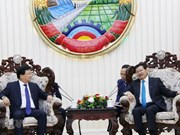 Deputy PM Dung meets Lao Prime Minister, NA Chairwoman