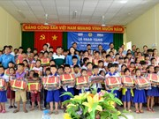 Lifebuoys designed like schoolbags presented to An Giang students