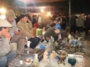 Buying luck at Vieng Market