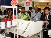 Foreign businesses flock to int'l exhibitions in VN