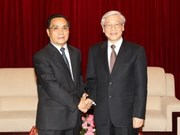 Party leader visits Laos