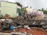 Tornadoes kill two, destroy many homes