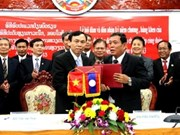 Hanoi, Vientiane trade unions boost cooperation