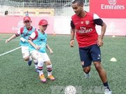 Arsenal players busy in Hanoi