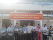 Nation's poor receive Tet gifts
