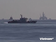 China sends four fighter aircraft to protect illegal rig