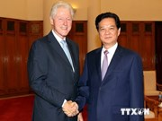 PM greets former US president Clinton