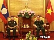 Vietnam, Laos army mass organisations foster ties