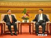 Vietnam, China agree to restore, develop ties