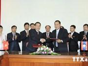 Vietnamese, Lao news agencies boost cooperation
