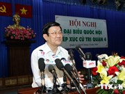 President meets voters in HCM City