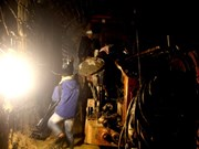 Rescuers try to pump water out of collapsed tunnel