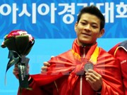 Vietnam pins hope of Olympic gold on weightlifter Tuan