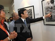 State President visits AP's first war photo exhibition