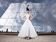 Vietnamese model's show set against solar backdrop