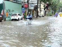 Heavy rain floods some Hanoi streets