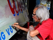 Painter of hand-colouring posters