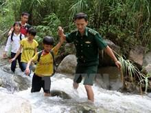 Students walk bumpy roads to school in mountainous areas