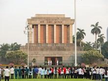Flag salute ceremony celebrates President Ho Chi Minh's 128th birthday