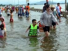 Children having fun in natural swimming pool
