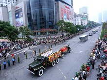 People take to street, pay last respects to President Tran Dai Quang