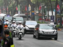 Kim Jong-un's convoy leaves hotel for summit