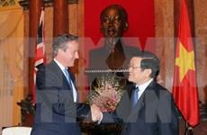 President Truong Tan Sang greets UK Prime Minister