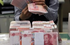 Yuan depreciation may hurt Singapore's economy