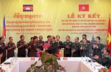 Vietnamese, Cambodian localities beef up military ties