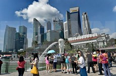 Singapore's ruling party, opposition unveil election manifesto